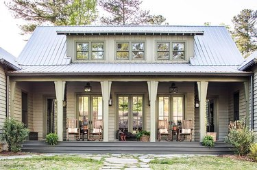 green/gray home with gray roof and porch