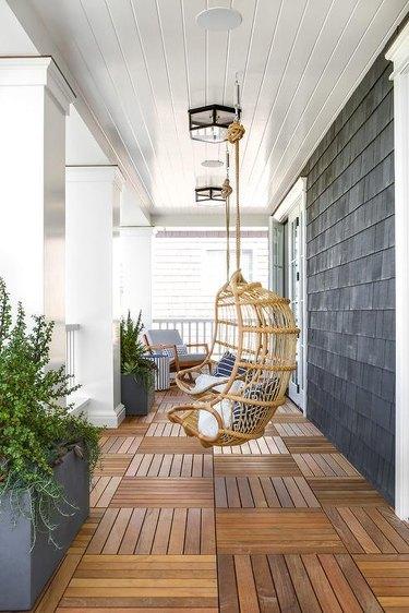 gray shingled home with wood floor