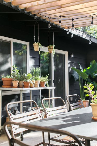 black exterior with outdoor patio and potting area