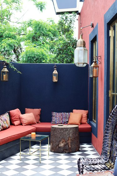 colorful outdoor patio with wall seating and throw pillows