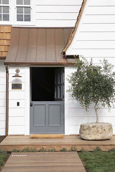 white farmhouse with Dutch door