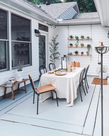 dining area on outdoor patio with vertical garden