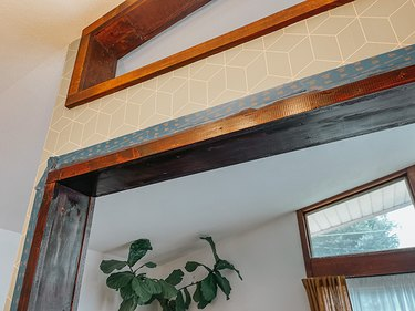 Add stain to the unfinished wood trim of the cutout.