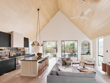 open concept living room with cathedral ceiling
