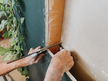 Use a carpenter's square to translate the corners of the cutout to the opposite side of the wall.