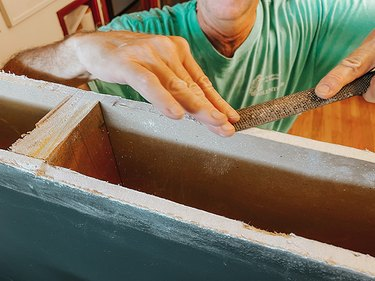 Clean any rough patches on the cut drywall using a rasp.