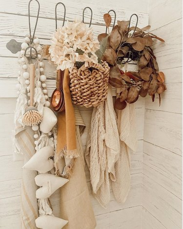 coat rack with fall decor