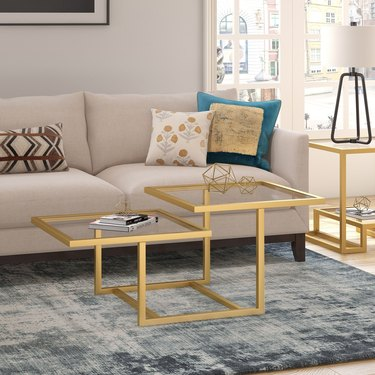 Brass coffee table with two square levels and glass tops