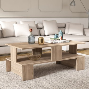 Rectangular wood coffee table with lots of open shelves