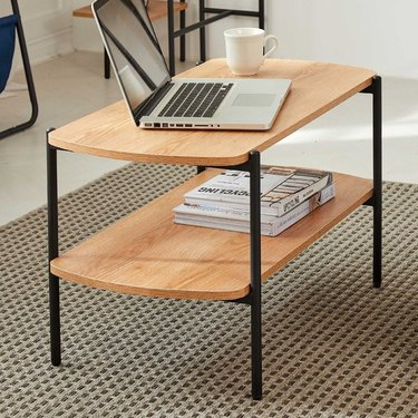 Wood coffee table with lower shelf and black metal legs
