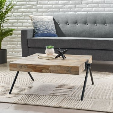 Wood coffee table with metal angular legs