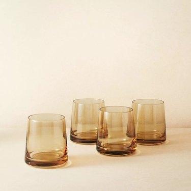 four tinted tumbler glasses
