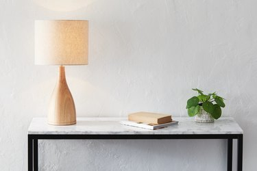 Table lamp on marble consol
