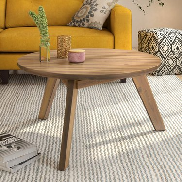 Small round wood tripod coffee table