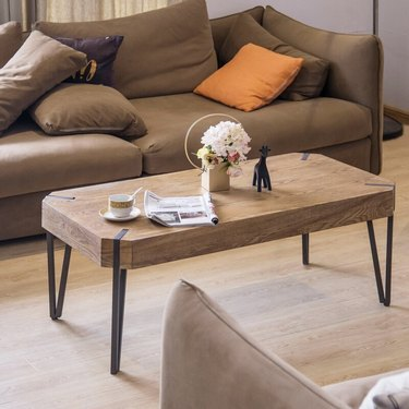 Rounded rectangular wood coffee table with black metal legs