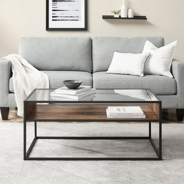 Metal framed coffee table with glass top and wood veneer open shelf