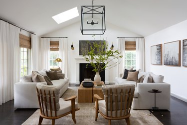 living room with cage pendant light an unusual chairs