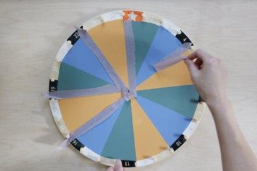 Pulling tape off painted IKEA kids activity wheel