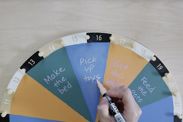 Writing kids' chores on painted IKEA activity wheel