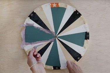 Pulling painter's tape off IKEA kids activity wheel