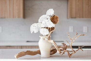 Vase, flowers, cabinets.