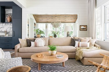 living room with large tan sectional