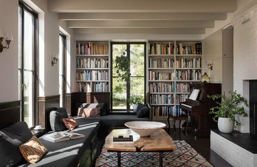 living room with floor to ceiling bookshelves