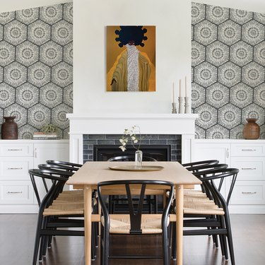 dining room with gray geometric wallpaper