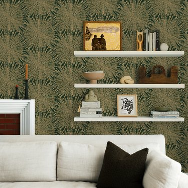 emerald green starburst wallpaper behind white sofa