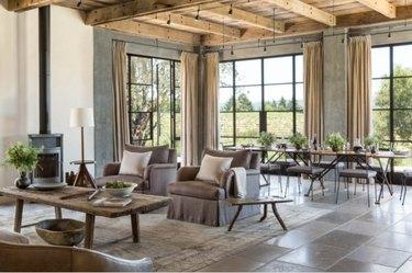living room with limestone flooring a cross beam wood ceiling