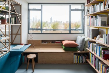 window seat near bookshelves and view of the outside