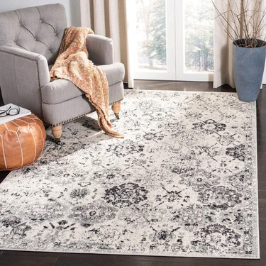 Distressed patterned area rug