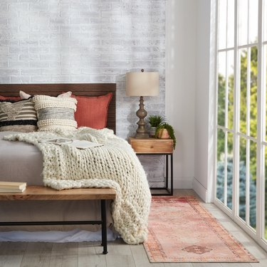 Bedroom with rug and bed