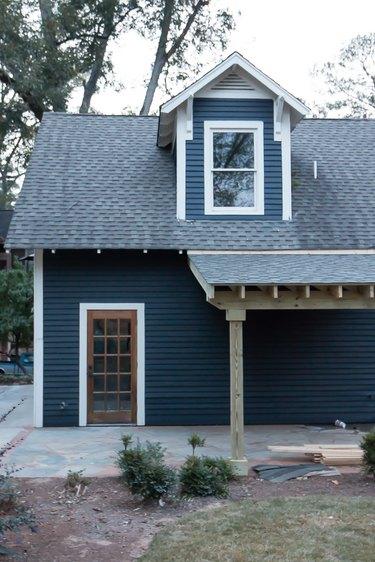 navy blue farmhouse exterior