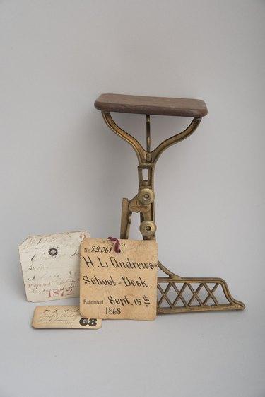 wood desk on brass base