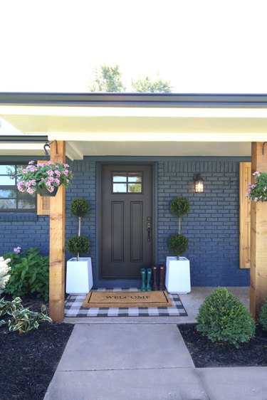 navy blue farmhouse exterior with wood posts