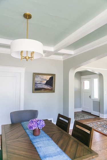 Craftsman style living room with ceiling detail and gold fixtures.