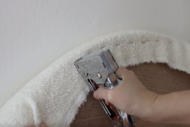 Stapling boucle fabric to back of headboard