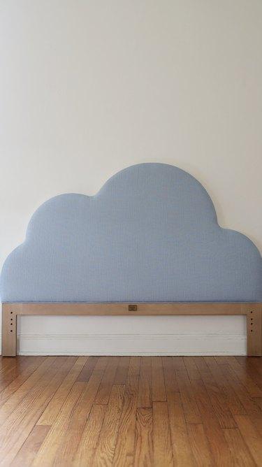 Drew Barrymore Flower Home cloud headboard with blue linen fabric