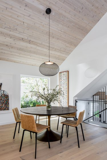 dining area with round table and hanging light fixture