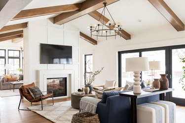 farmhouse living room with wood ceiling beams