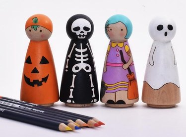 colored pencils and four halloween peg dolls