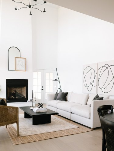 black and white transitional living room with layered rugs