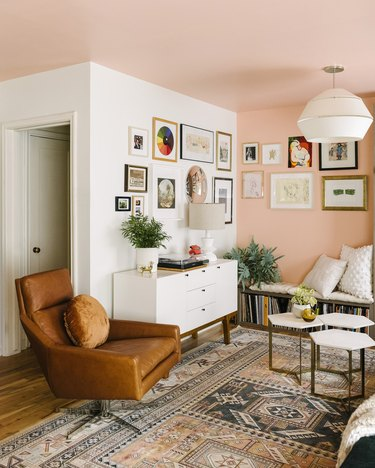 pink and white living room with gallery wall