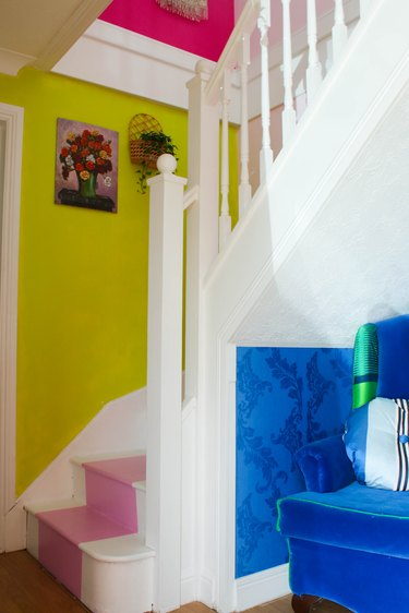 bright yellow accent wall on staircase