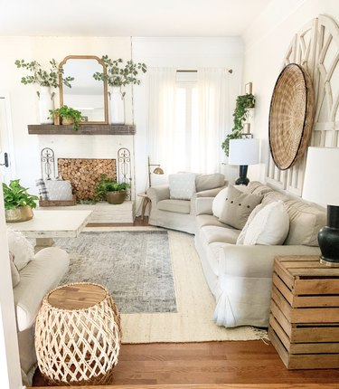 farmhouse living room with dark gray rug on top of white area rug