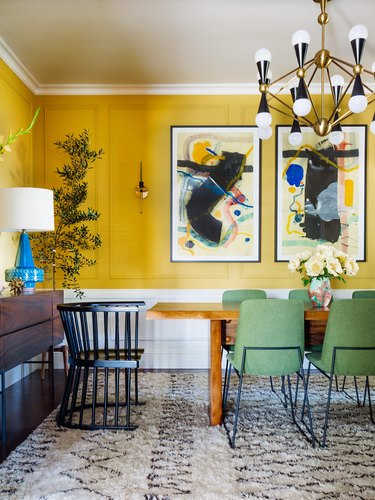 yellow and white dining room with midcentury decor