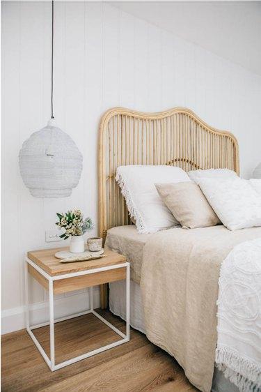 white minimalist bedroom with bamboo headboard