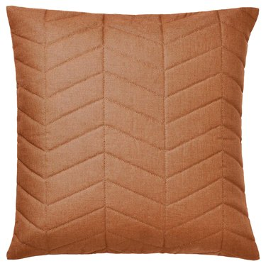 orange pillow cover with chevron-like pattern