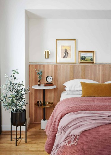 small bedroom with modern wood wall treatment